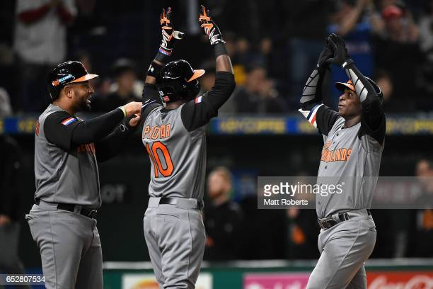 Desingated hitter Didi Gregorius of the Netherlands celebrates with Outfielder Wladimir Balentien and Outfielder Jurickson Profar after hitting a...