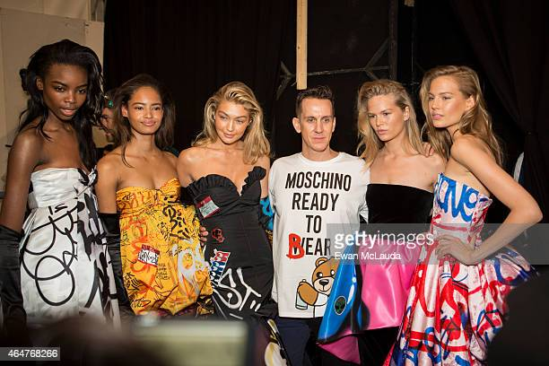 Desinger Jeremy Scott and models pose backstage ahead of the Moschino show during the Milan Fashion Week Autumn/Winter 2015 on February 26 2015 in...
