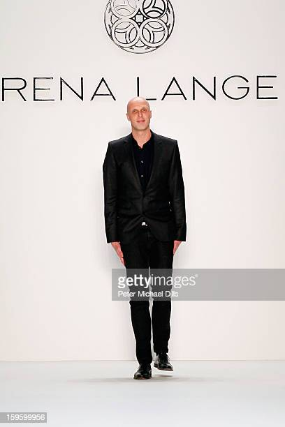 Desinger Karsten Fielitz acknowledges the audience at Rena Lange Autumn/Winter 2013/14 fashion show during Mercedes-Benz Fashion Week Berlin at...