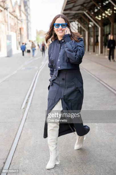 Desinger Kym Ellery walks and talks on the phone during MercedesBenz Fashion Week Resort 18 Collections at Carriageworks on May 15 2017 in Sydney...