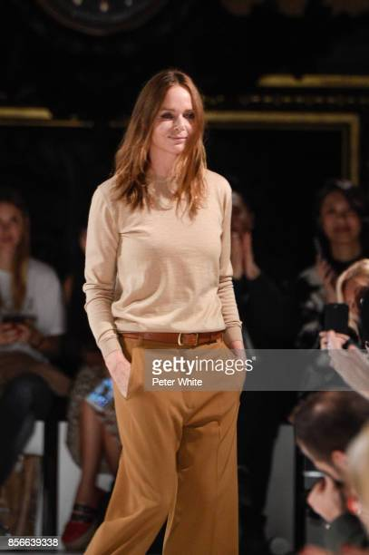 Desinger Stella McCartney acknowledges the audience at the end of her show as part of the Paris Fashion Week Womenswear Spring/Summer 2018 on October...