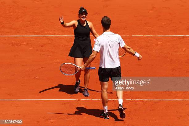 Desirae Krawczyk of The United States and playing partner Joe Salisbury of Great Britain celebrate match point in their Mixed Doubles Final match...