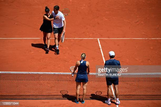 Desirae Krawczyk of the US and Britain's Joe Salisbury celebrate after winning their mixed doubles final tennis match against Russia's Elena Vesnina...