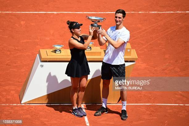 Desirae Krawczyk of the US and Britain's Joe Salisbury pose with The Marcel Bernard Cup after winning their mixed doubles final tennis match against...