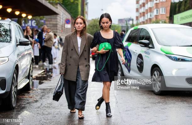 Desirée Kastull wearing brown blazer and Nisi Kastull wearing black dress seen outside Saks Potts during Copenhagen Fashion Week Spring/Summer 2020...