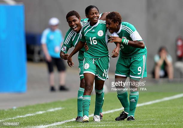 Desire Oparanozie of Nigeria celebrates after scoring her team's first goal with team mates Osinachi Ohale and Amarachi Okoronkwo during the FIFA U20...
