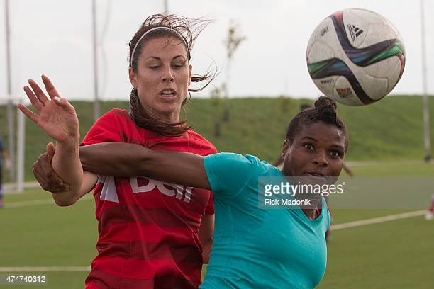 TORONTO MAY 22 Desire Oparanozie of Nigeria keeps Canada's Emily Zurrer at bay Canada VS Nigeria during 2nd half action in a pre Women's World Cup...