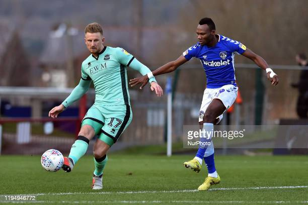 Desire Segbe Azankpo of Oldham Athletic and Byron Webster during the Sky Bet League 2 match between Oldham Athletic and Carlisle United at Boundary...