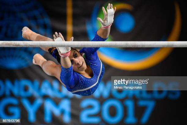 Desiree Carofiglio of Italy competes on the uneven bars during the qualification round of the Artistic Gymnastics World Championships on October 4...