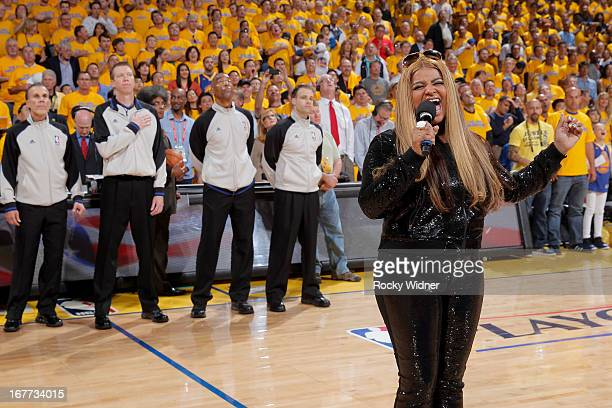 Desiree Coleman Jackson wife of Golden State Warriors Head Coach Mark Jackson sings the National Anthem prior to Game Four of the Western Conference...