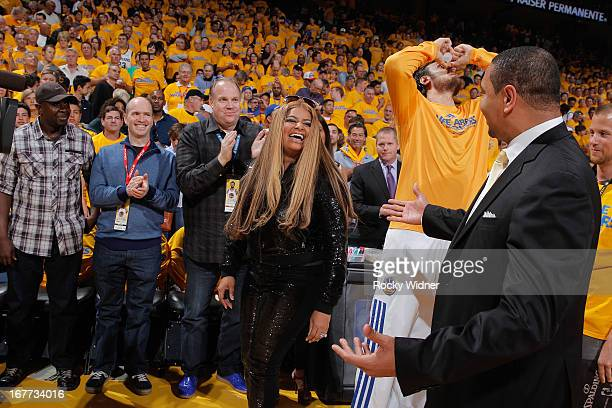 Desiree Coleman Jackson wife of Golden State Warriors Head Coach Mark Jackson greets her husband after singing the National Anthem prior to Game Four...