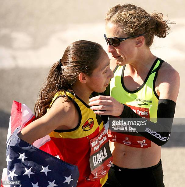 Desiree Davila consoles Amy Hastings after they competed in the US Marathon Olympic Trials January 14 2012 in Houston Texas Hastings finished in...