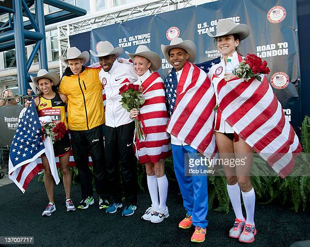 Desiree Davila Ryan Hall Abdi Abdirahman Shalane Flanagan Meb Keflezighi and Kara Goucher pose on the winners stage during US Marathon Olympic Trials...