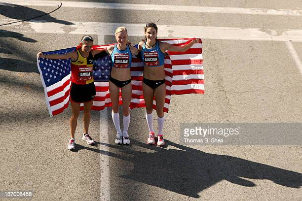 Desiree Davila Shalane Flanagan and Kara Goucher celebrate as they hold American flags after the US Marathon Olympic Trials January 14 2012 in...