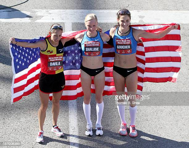 Desiree Davila Shalane Flanagan and Kara Goucher celebrate while holding American flags after the US Marathon Olympic Trials January 14 2012 in...
