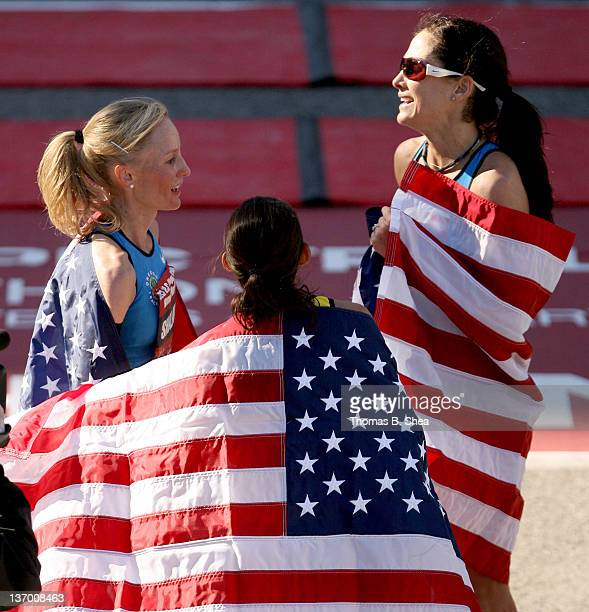 Desiree Davila Shalane Flanagan and Kara Goucher celebrate with American flags after the US Marathon Olympic Trials January 14 2012 in Houston Texas