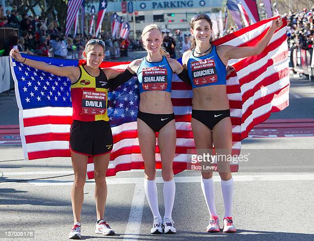 Desiree Davila Shalane Flanagan and Kara Goucher pose with American flags after qualifying in the US Marathon Olympic Trials on January 14 2012 in...