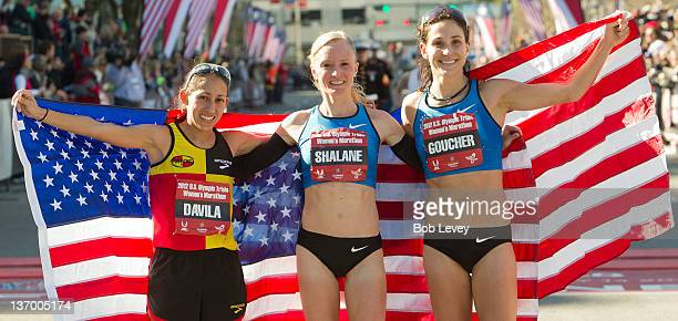 Desiree Davila Shalane Flanagan and Kara Goucher pose with the American flag after qualifying in the US Marathon Olympic Trials on January 14 2012 in...