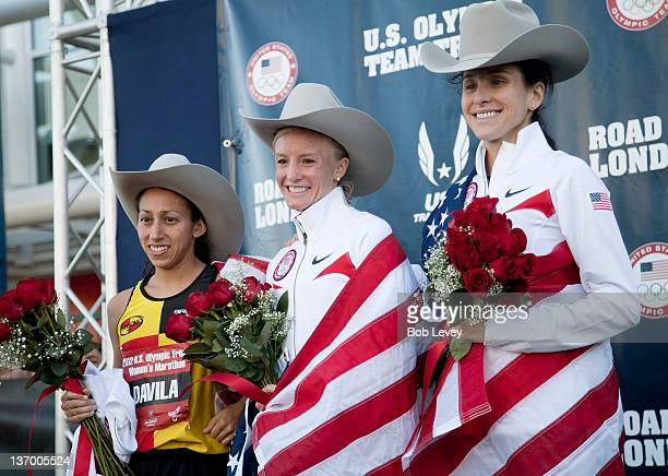 Desiree Davila Shalane Flanagan and Kara Goucher poses on the winners podium with their cowboy hats after taking the top three spots during US...
