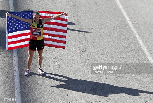 Desiree Davila who finished with a time of 22555 holds an American flag after the US Marathon Olympic Trials January 14 2012 in Houston Texas
