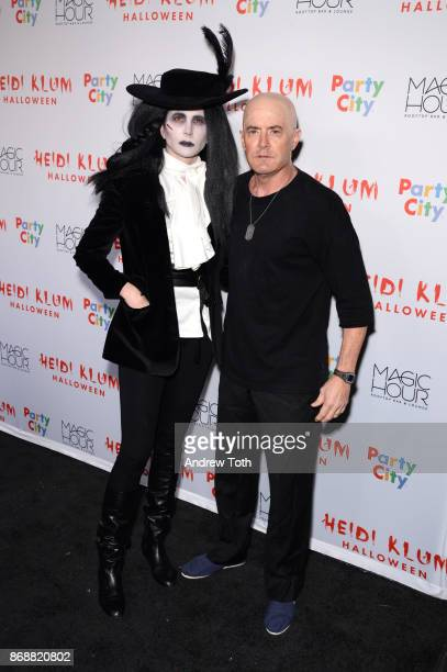 Desiree Gruber and Kyle MacLachlan attend Heidi Klum's 18th annual Halloween party at Magic Hour Rooftop Bar Lounge on October 31 2017 in New York...