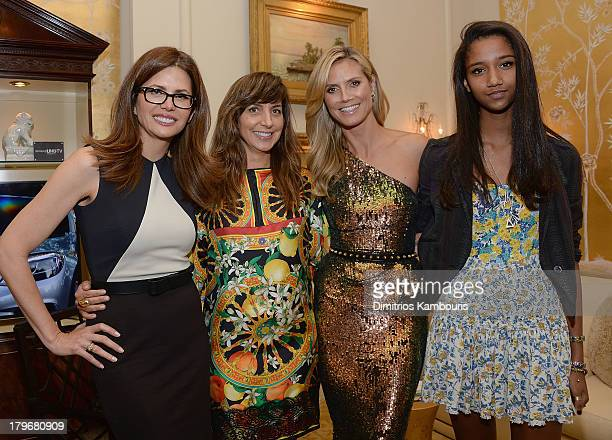 Desiree Gruber Monica Mitro Heidi Klum and Aiden Curtis attend the Project Runway show during Spring 2014 MercedesBenz Fashion Week at The Theatre at...
