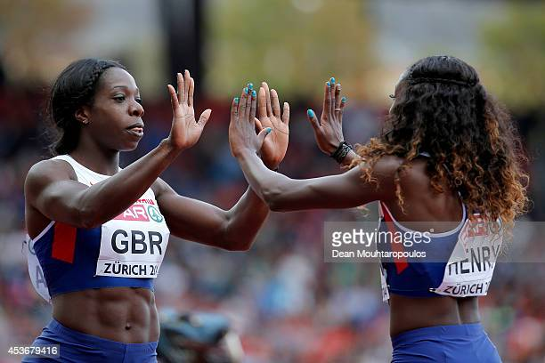 Desiree Henry and Anyika Onuora of Great Britain and Northern Ireland celebrate after the Women's 4x100 metres relay heats during day five of the...