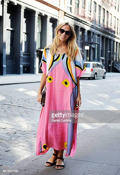 Desiree is seen around Soho wearing an Andanuroj dress vintage bag and HM sunglasses on June 30 2014 in New York City