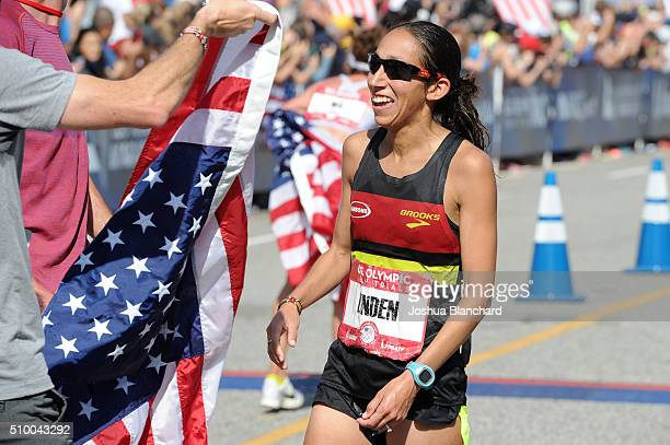 Desiree Linden is handed her United States Flag after her secong place qualifing finish in the US Olympic Team Trials Womens Marathon on February 13...