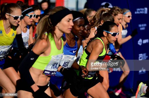 Desiree Linden of the the United States and athletes in the Women's Professional Division take off at the start of the TCS New York City Marathon on...