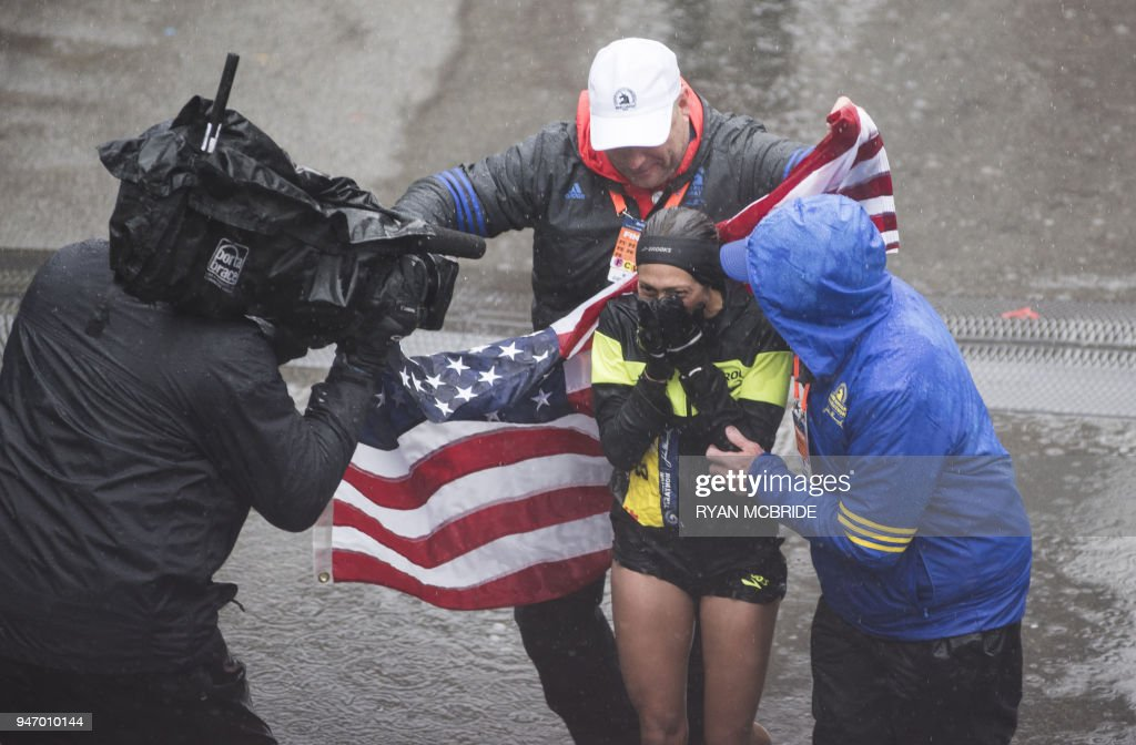 TOPSHOT - Desiree Linden of the US celebrates after crossing the finish line as the winner of the 2018 and 122nd Boston Marathon for Elite Women's race with a time of 2:39:5.in Boston, Massachusetts. Her personal best finish was previously second place in the Boston Marathon in 2011 with a time of 2:22:38. /