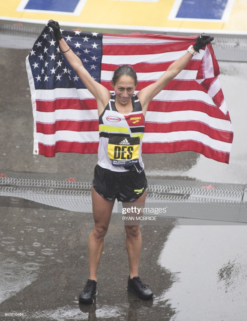 Desiree Linden of the US celebrates after crossing the finish line as the winner of the 2018 and 122nd Boston Marathon for Elite Women's race with a time of 2:39:5.in Boston, Massachusetts. Her personal best finish was previously second place in the Boston Marathon in 2011 with a time of 2:22:38. /