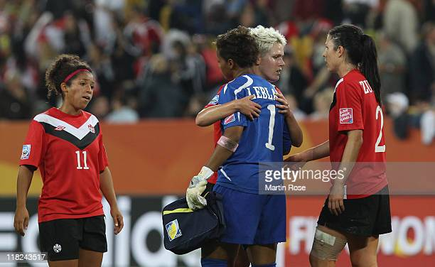Desiree Scott Karina LeBlanc Sophie Schmidt and Emily Zurrer of Canada looks dejected after the FIFA Women's World Cup 2011 Group A match between...