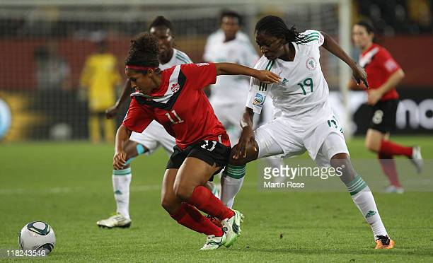 Desiree Scott of Canada and Uchechi Sunday of Nigeria battle for the ball during the FIFA Women's World Cup 2011 Group A match between Canada and...