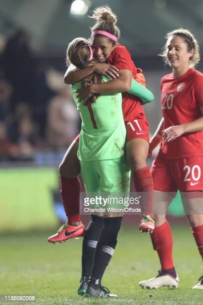 Desiree Scott of Canada celebrates their win with goalkeeper Stephanie Labbe during the International Friendly between England Women and Canada Women...