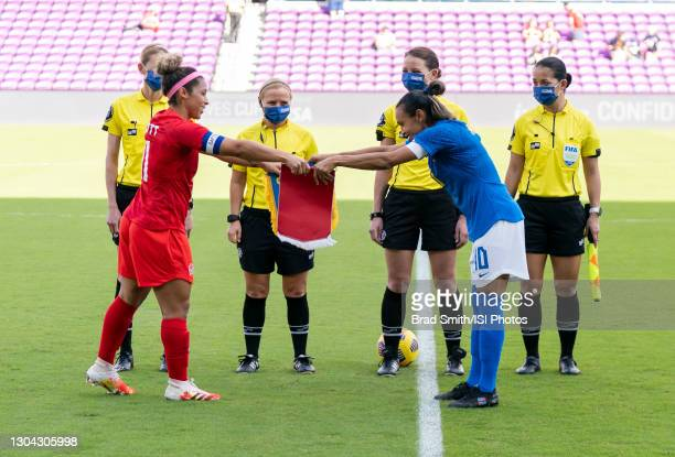 Desiree Scott of Canada exchanges a banner with Marta of Brazil before a game between Brazil and Canada at Exploria Stadium on February 24, 2021 in...