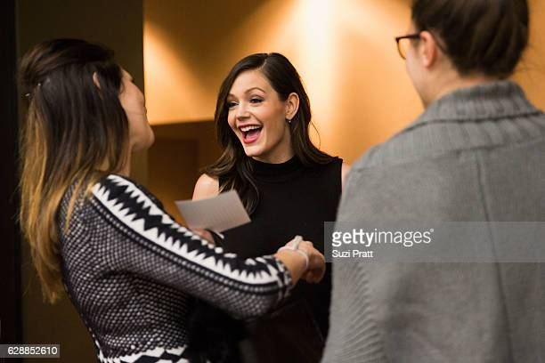 Desiree Siegfried interacts with friends at the Gilt City Sample Sale on December 9 2016 in Seattle Washington