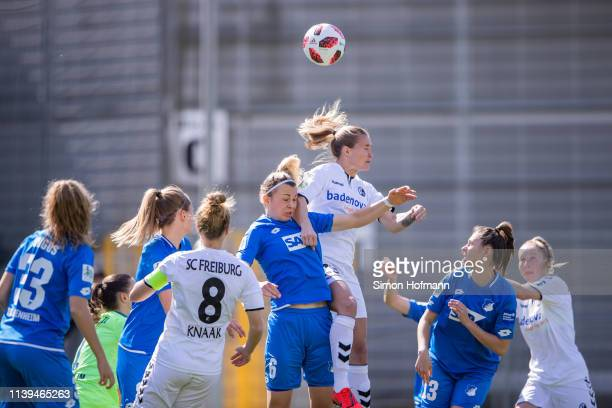 Desiree van Lunteren of Freiburg jumps for a header with Lena Lattwein of Hoffenheim during the Women's DFB Cup Semi Final between TSG Hoffenheim and...