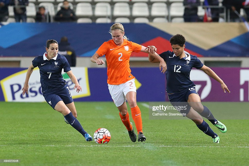 Desiree van Lunteren #2 of Netherlands tries to control the ball against Aurelie Kaci #7 and Valerie Gauvin #12 of France during the international friendly game between France and Netherlands at Stade Jean Bouin on October 23, 2015 in Paris, France.