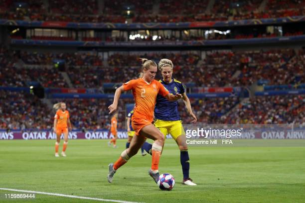 Desiree Van Lunteren of the Netherland is challenged by Lina Hurtig of Sweden during the 2019 FIFA Women's World Cup France Semi Final match between...