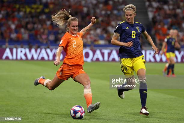 Desiree Van Lunteren of the Netherlands crosses the ball under pressure from Lina Hurtig of Sweden during the 2019 FIFA Women's World Cup France Semi...