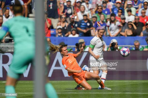Desiree Van Lunteren of the Netherlands defends Megan Rapinoe of the United States during the 2019 FIFA Women's World Cup France final match between...