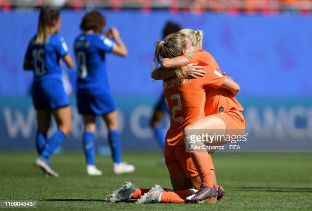 Desiree Van Lunteren of the Netherlands embraces teammate Kika Van Es as they celebrate victory after the 2019 FIFA Women's World Cup France Quarter...