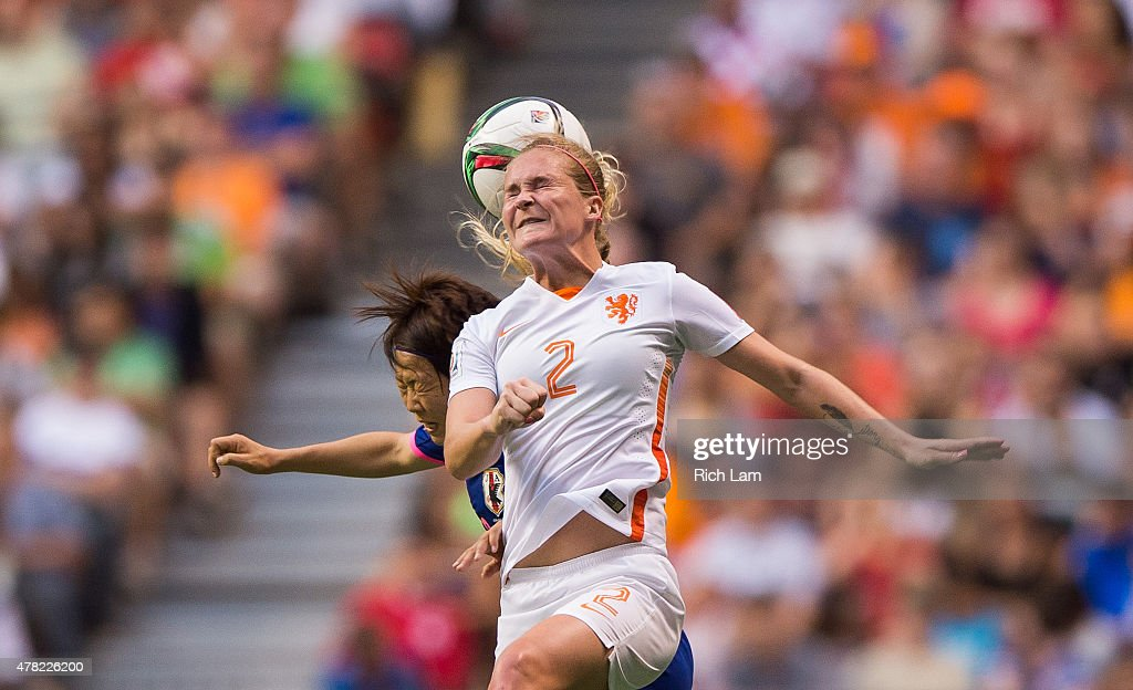 Desiree van Lunteren #2 of the Netherlands goes up for a ball while being challenged by Aya Miyama #8 of Japan during the FIFA Women's World Cup Canada 2015 Round of 16 match between the Netherlands and Japan June, 23, 2015 at BC Place Stadium in Vancouver, British Columbia, Canada.