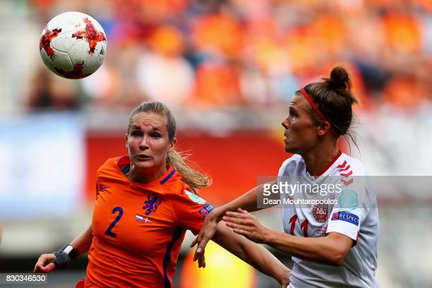 Desiree van Lunteren of the Netherlands holds off pressure from Katrine Veje of Denmark during the Final of the UEFA Women's Euro 2017 between...