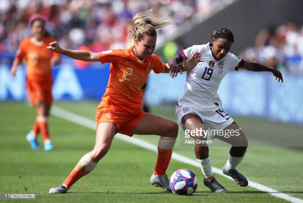 Desiree Van Lunteren of the Netherlands is challenged by Crystal Dunn of the USA during the 2019 FIFA Women's World Cup France Final match between...
