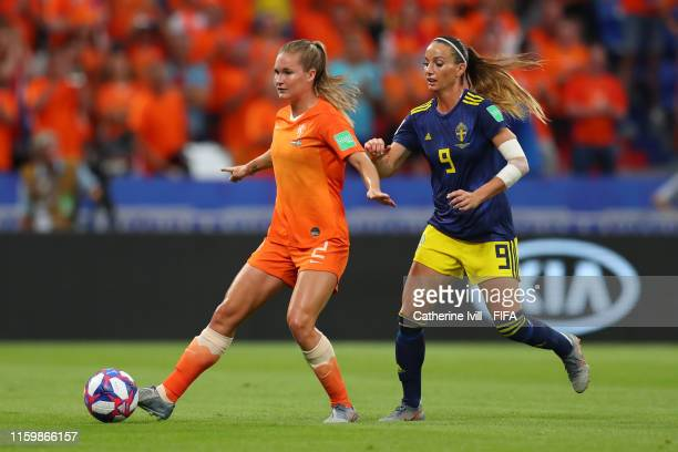Desiree Van Lunteren of the Netherlands is challenged by Kosovare Asllani of Sweden during the 2019 FIFA Women's World Cup France Semi Final match...