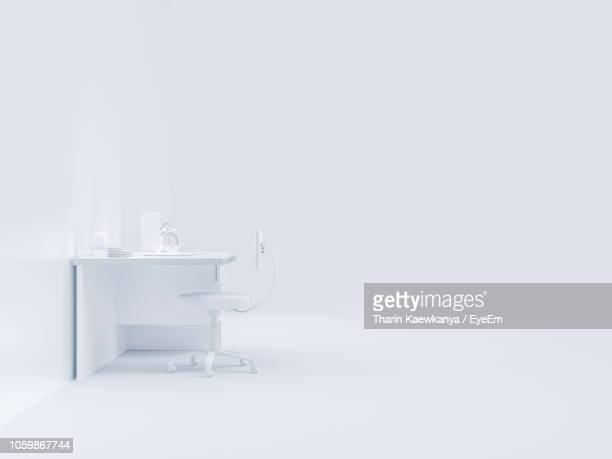 desk and chair against white background - 椅子 無人 ストックフォトと画像