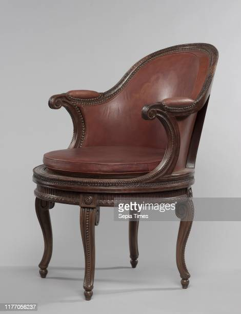 Desk Chair with Swivel Mechanism c 1780 France Paris 18th century Walnut with caning and leather upholstery overall 884 cm