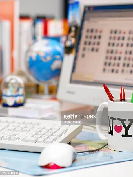 Desk in an Office Covered in Knick Knacks